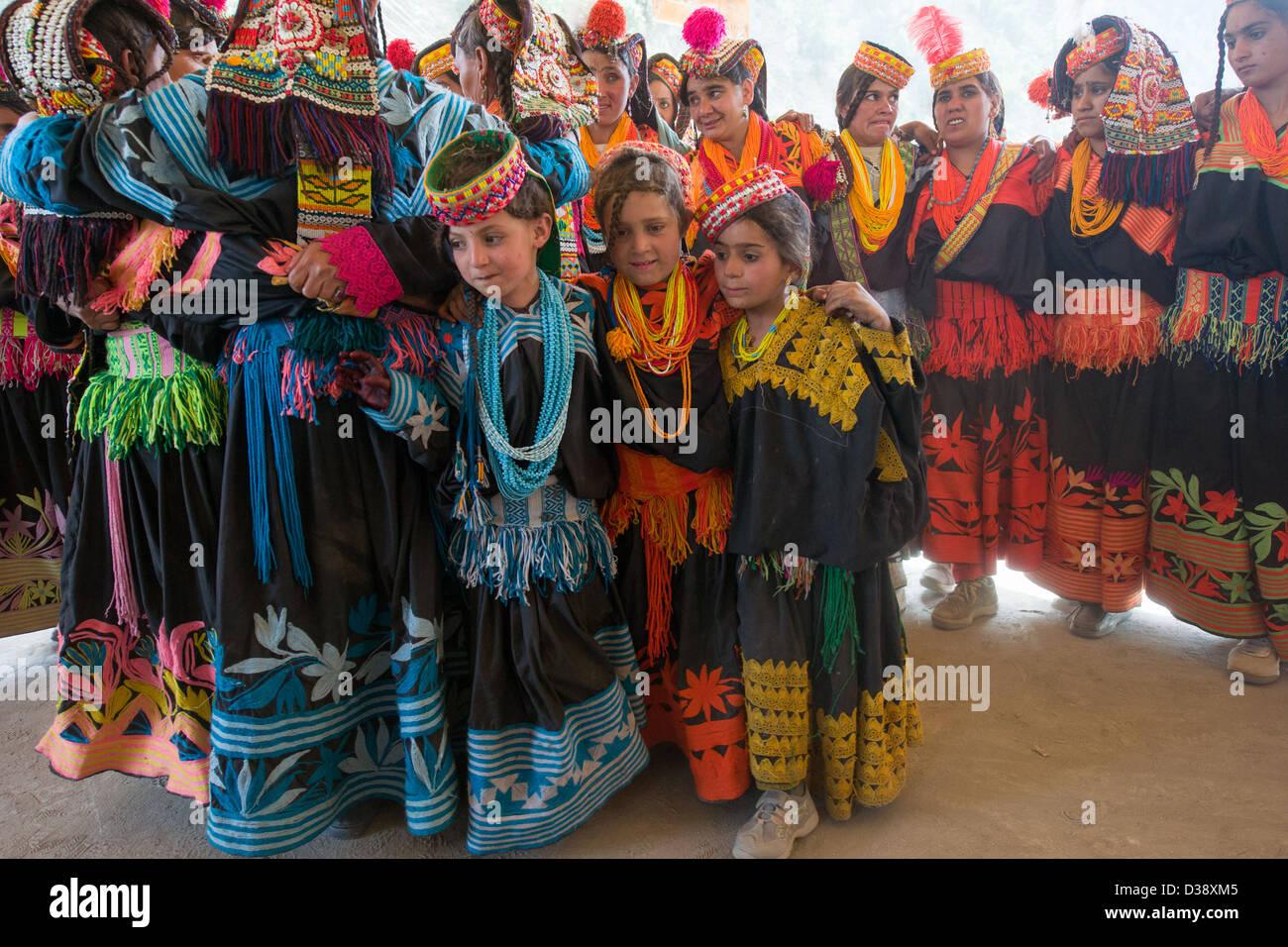 Young Kalash girls dancing in a cirlce of older women at the Kalash Joshi (Spring Festival), Grum Village Charso - Stock Image