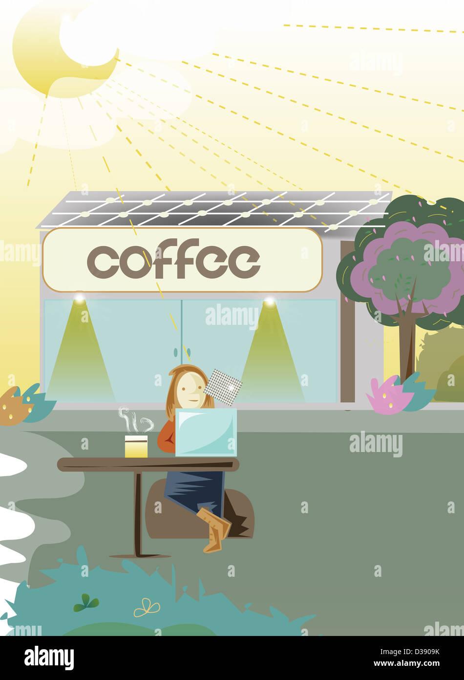 Woman using solar charging laptop - Stock Image