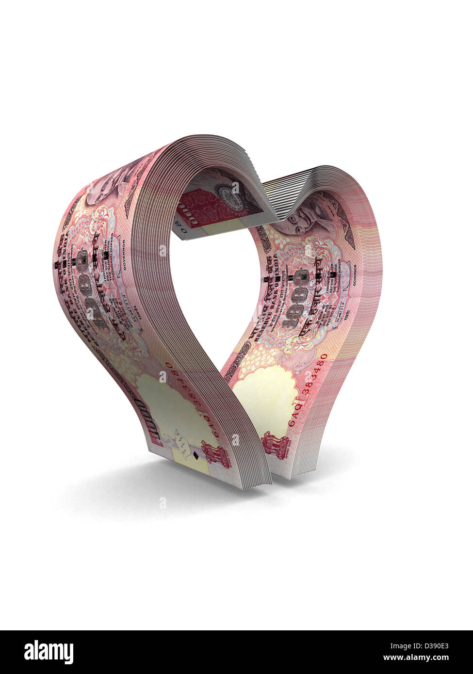 Indian currency notes forming heart shaped - Stock Image