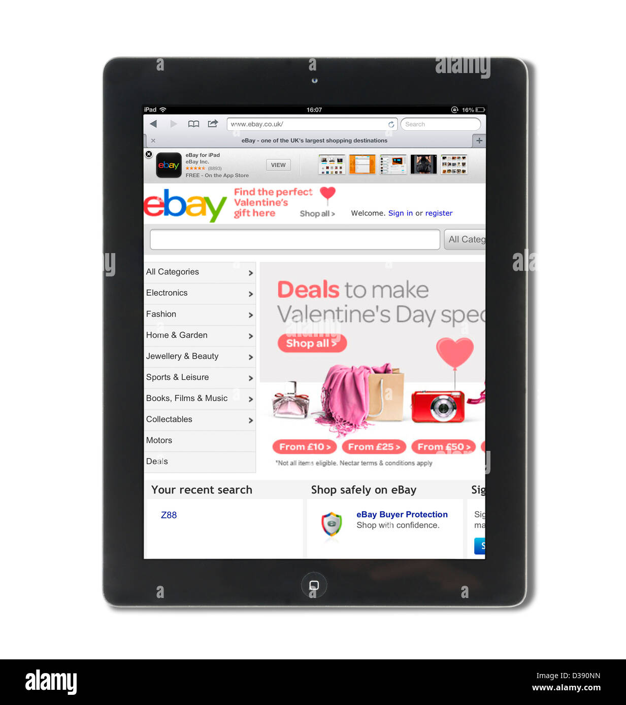 Browsing the ebay.co.uk website on a 4th generation Apple iPad tablet computer - Stock Image