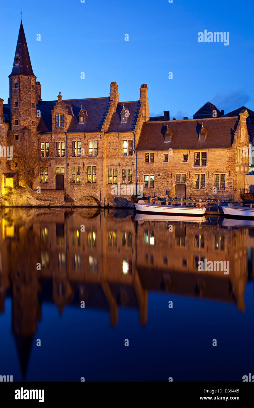 Historic buildings and boats on canal, Bruges, Belgium - Stock Image