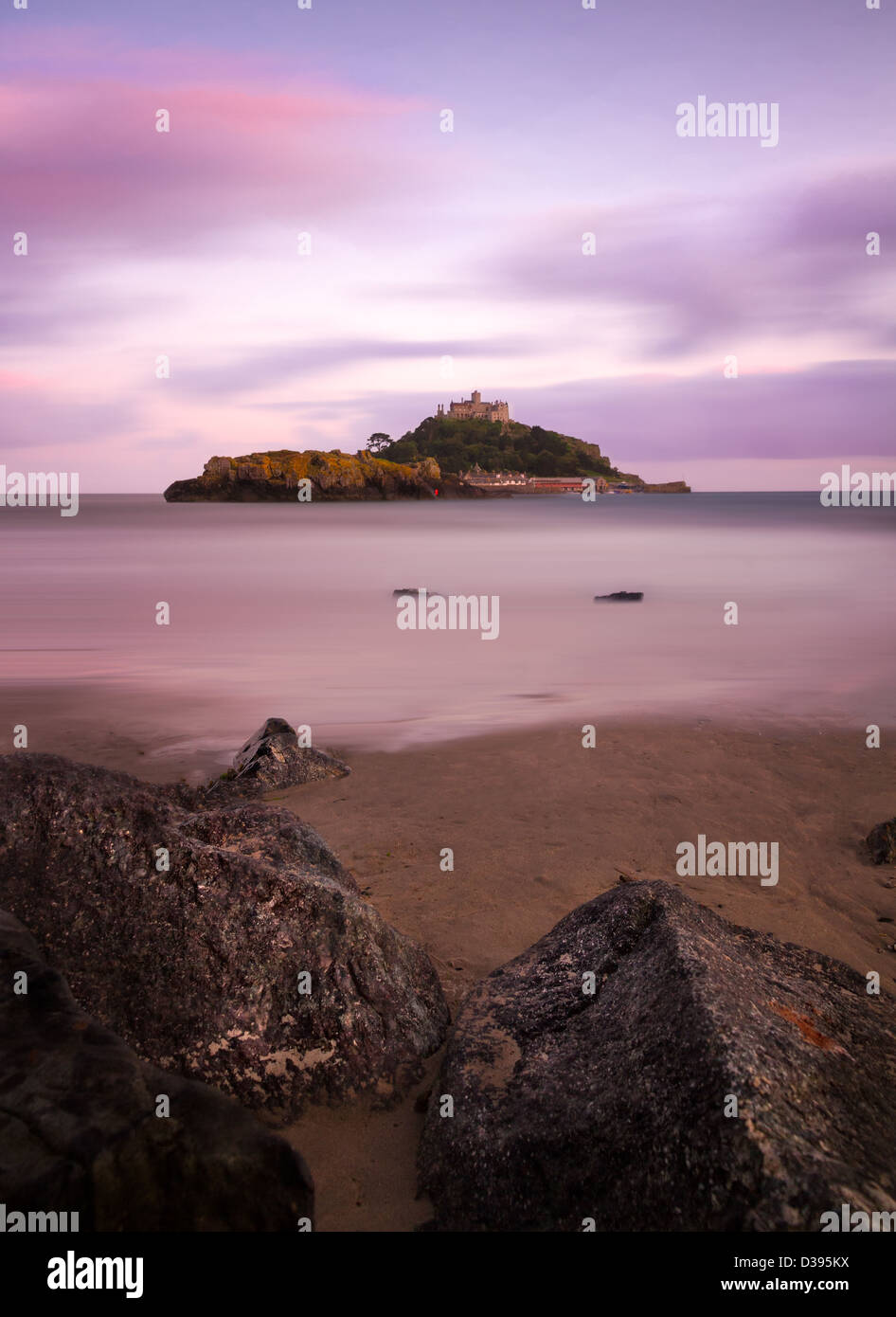 St. Michaels Mount with rocks at dusk, Cornwall, England - Stock Image