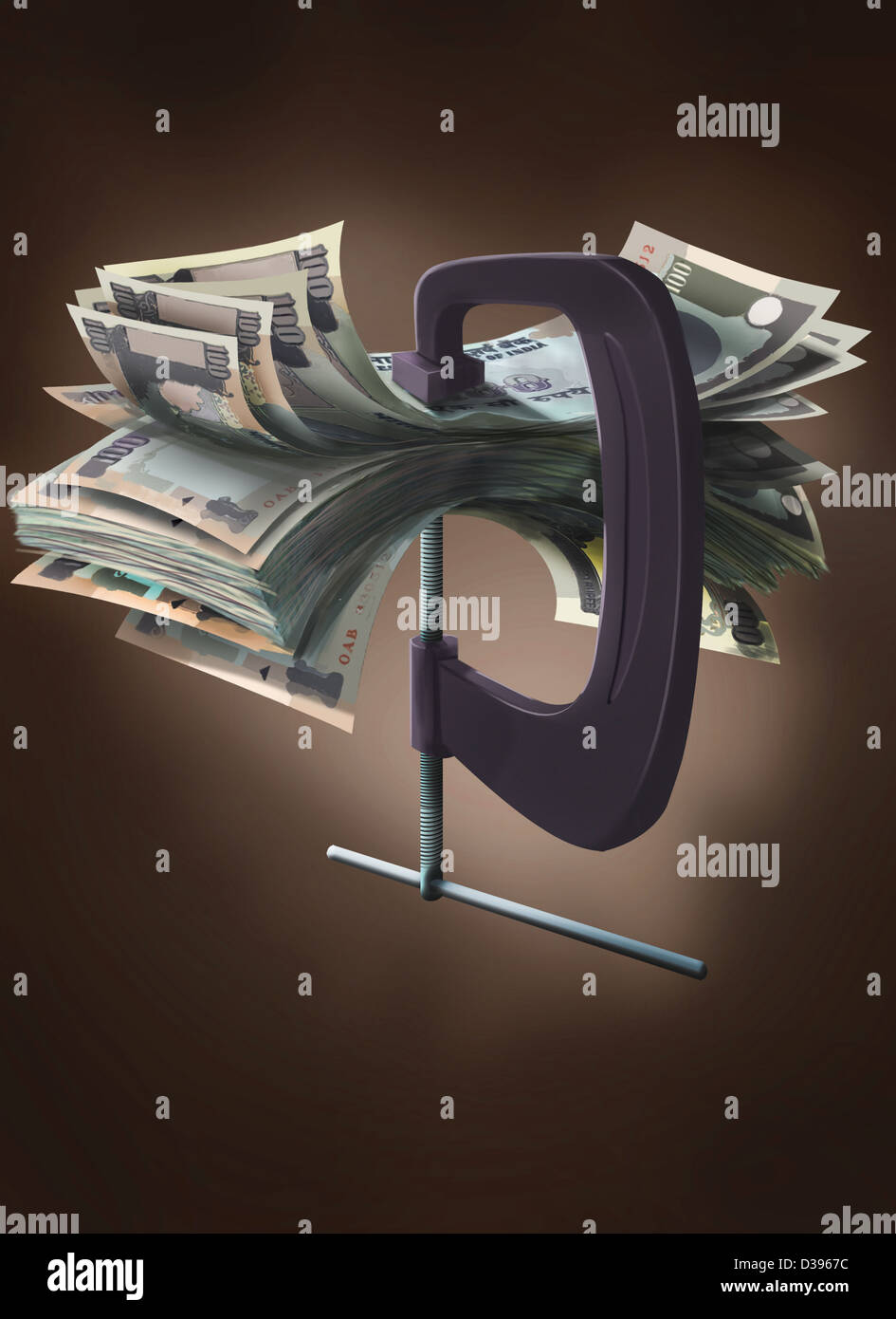 Indian currency notes in a vise grip of a clamp - Stock Image