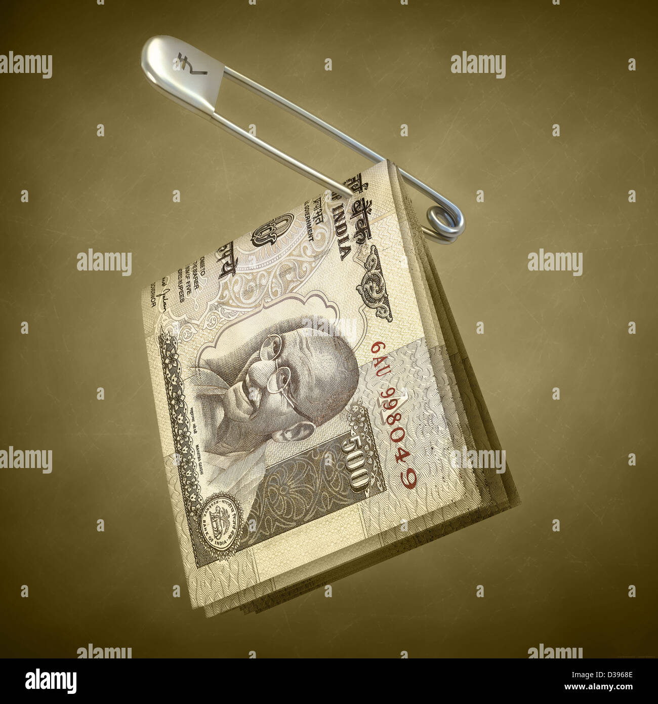Indian five hundred rupee notes pinned in a safety pin - Stock Image