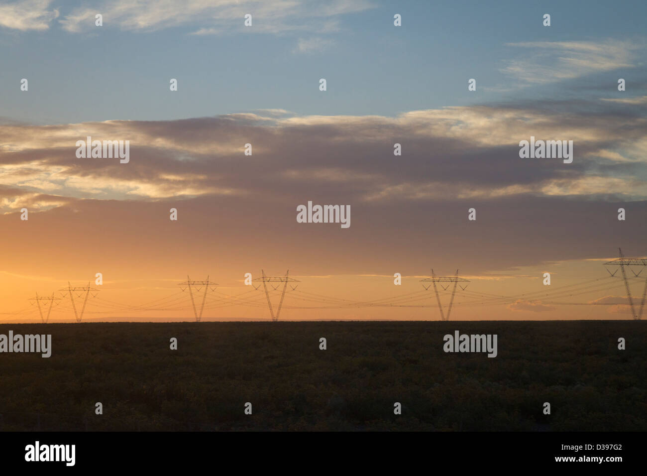 The muted sun fades below the horizon of the Argentine pampa region - Stock Image