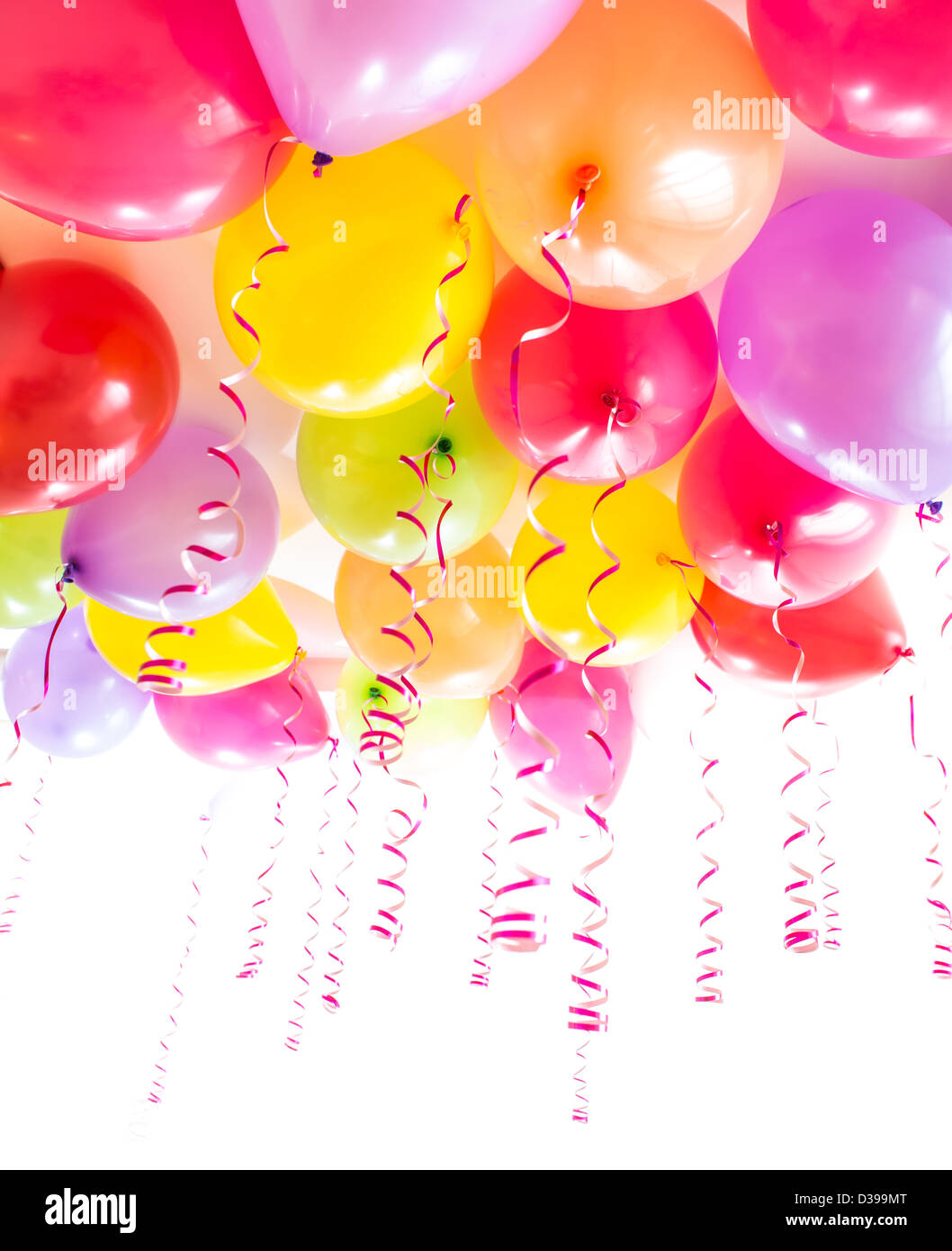 balloons with streamers for birthday party celebration isolated on white - Stock Image