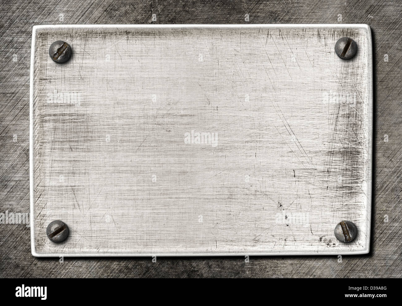 old scratched metal plate texture with screws - Stock Image