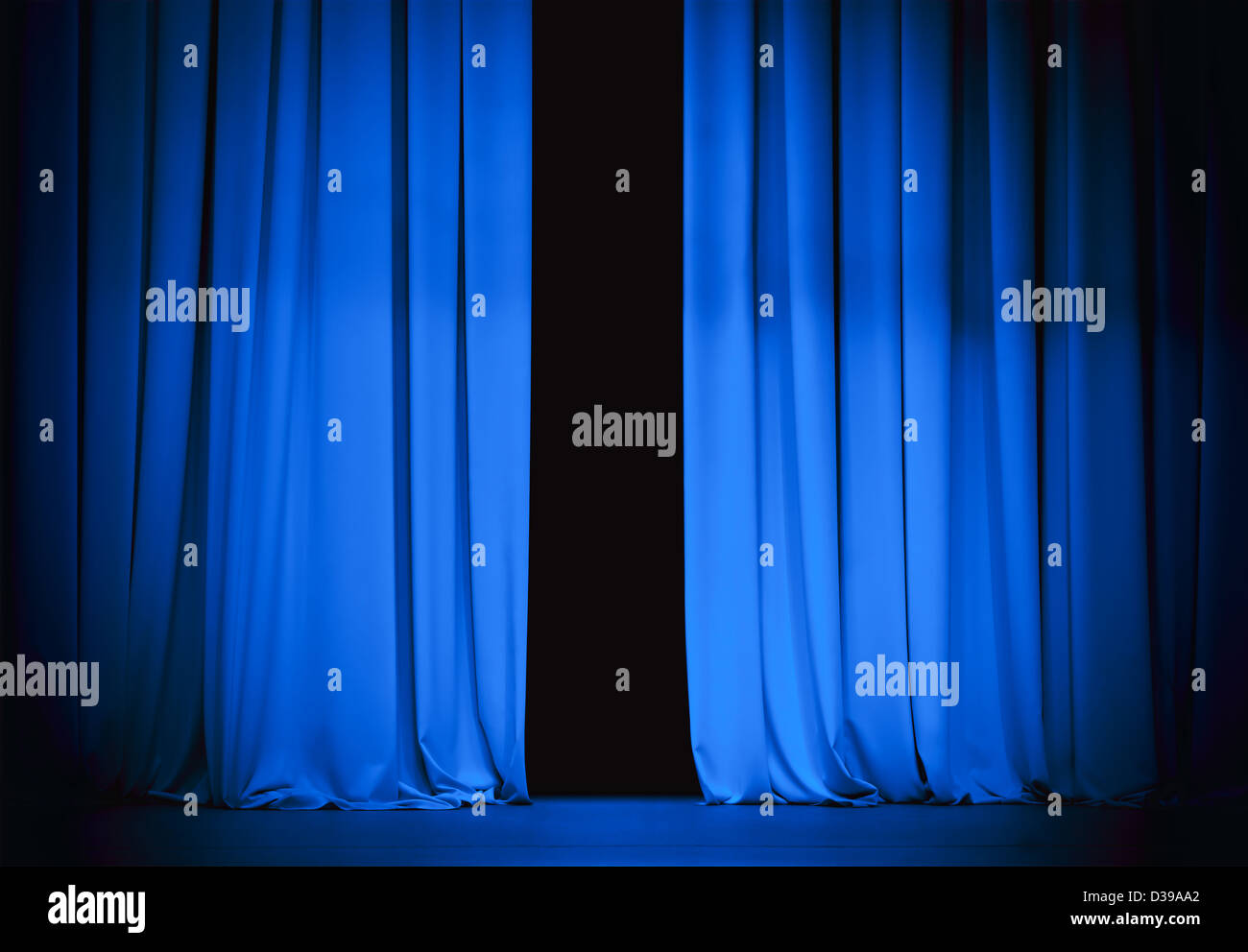 blue stage curtain slightly open - Stock Image