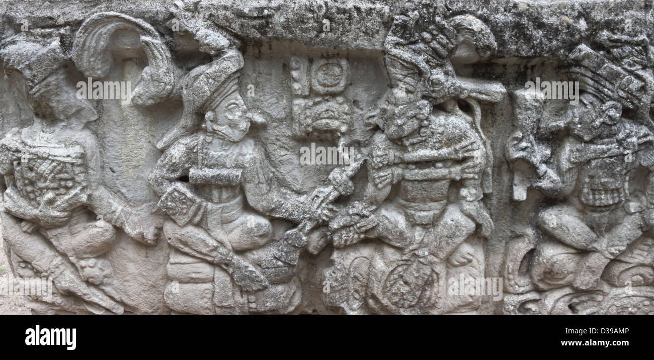 A detailed view of Mayan carvings on an altar at the ruins of Tikal in modern day Guatemala - Stock Image