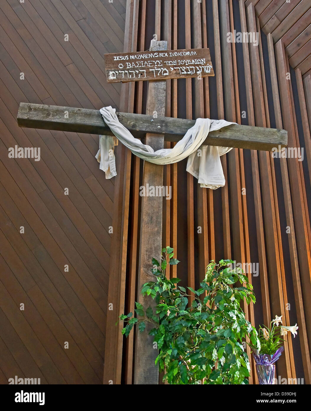 Easter Cross Is Inside A Church With White Cloth Draped Across It Rustic Sign Written In Hebrew Saying King Of The Jews