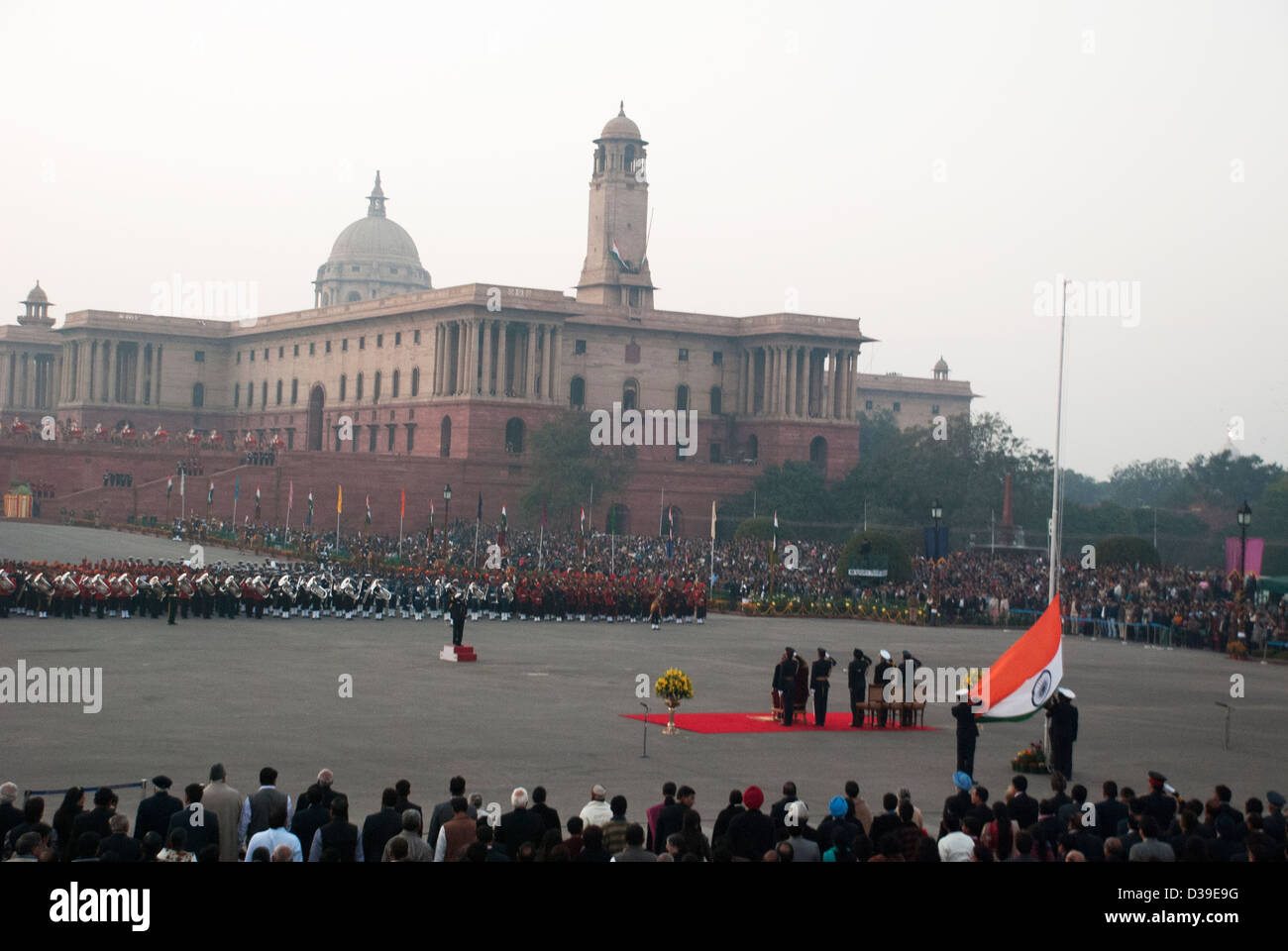 Flag being lowered at the end of Beating Retreat Ceremony. - Stock Image