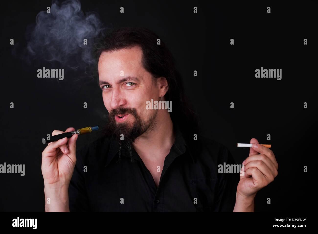 handsome man smoking e-cigarette - Stock Image