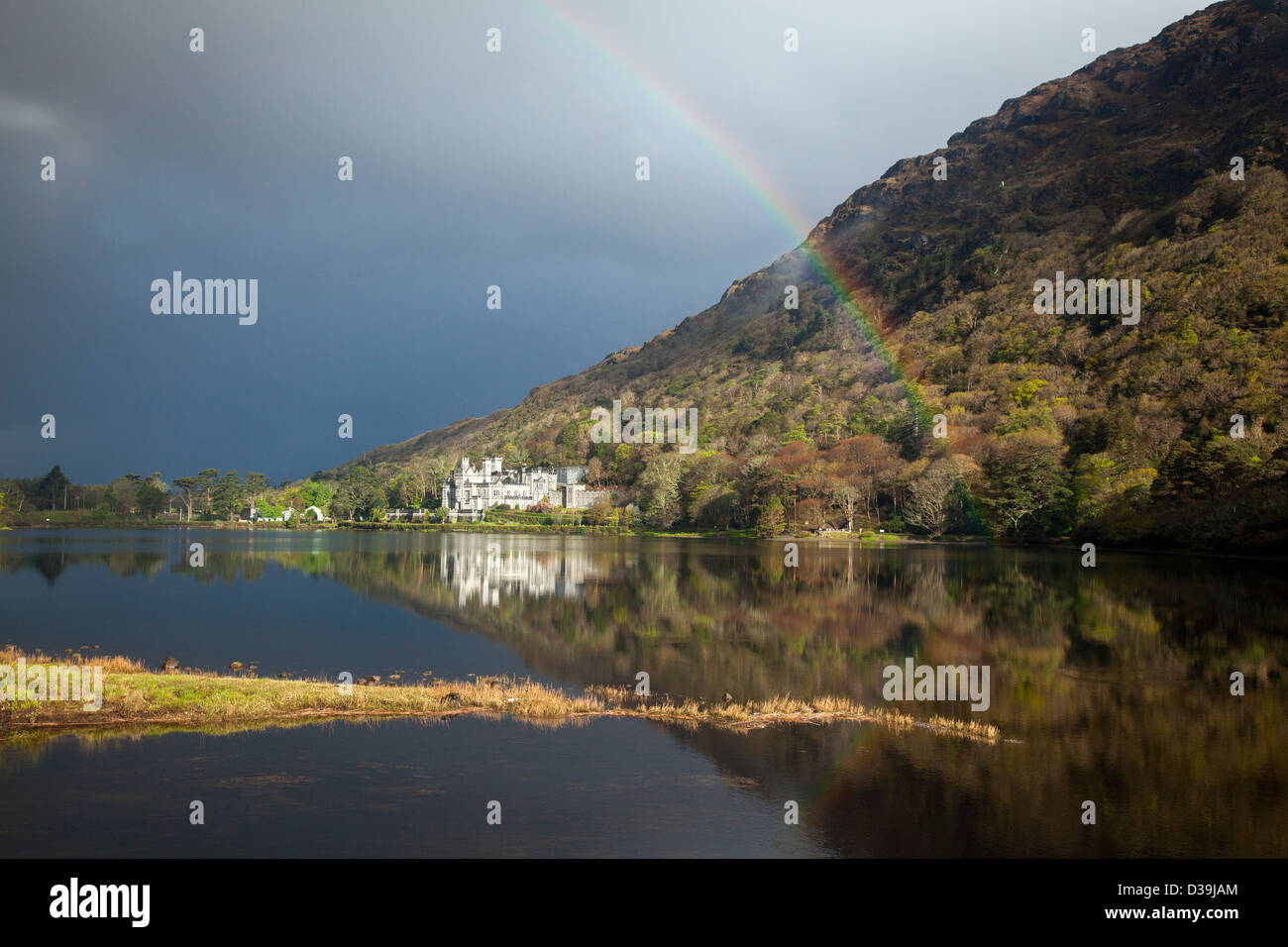 Rainbow over Kylemore Abbey, Connemara, County Galway, Ireland. - Stock Image