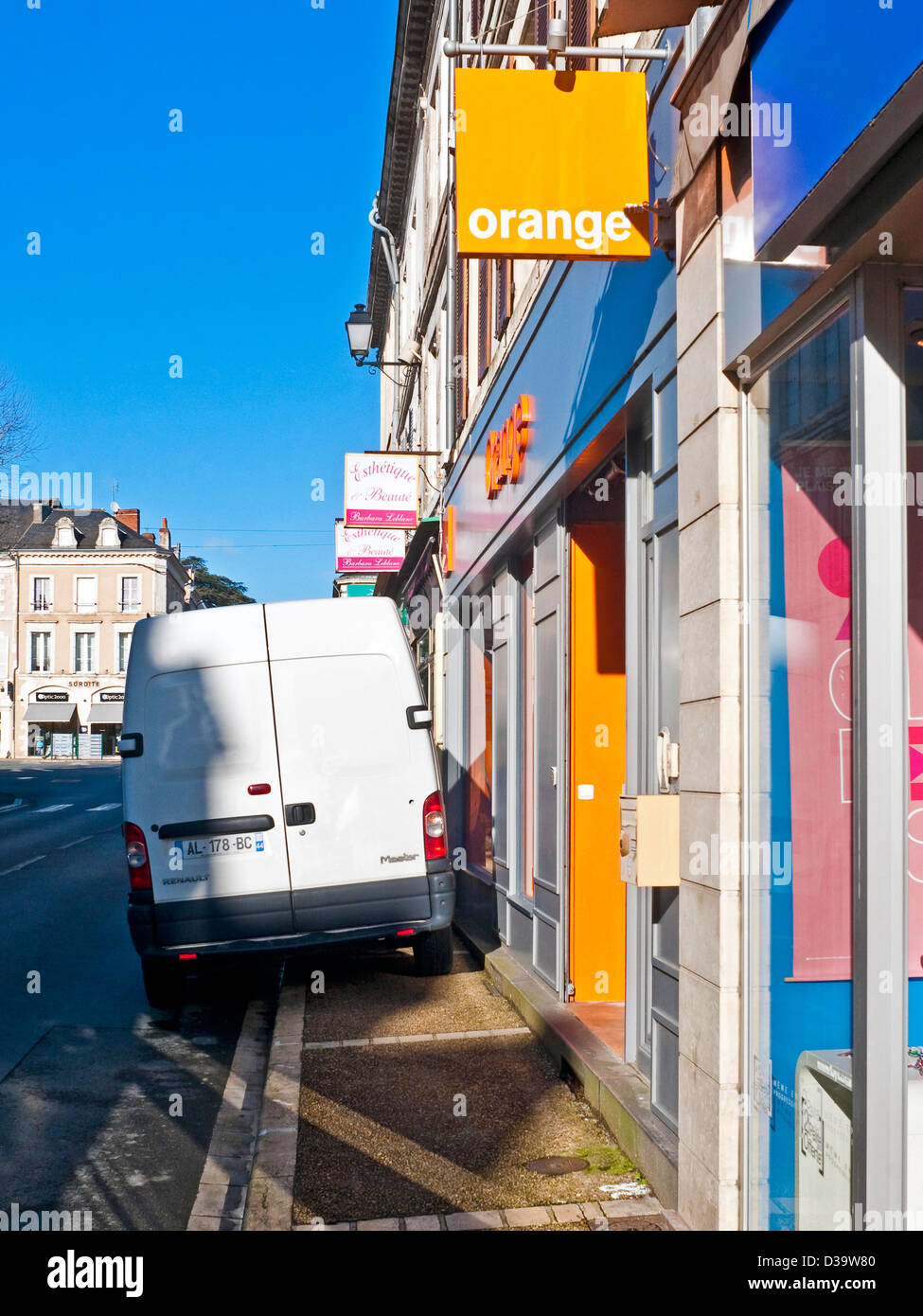 White van badly parked blocking pavement - France. Stock Photo