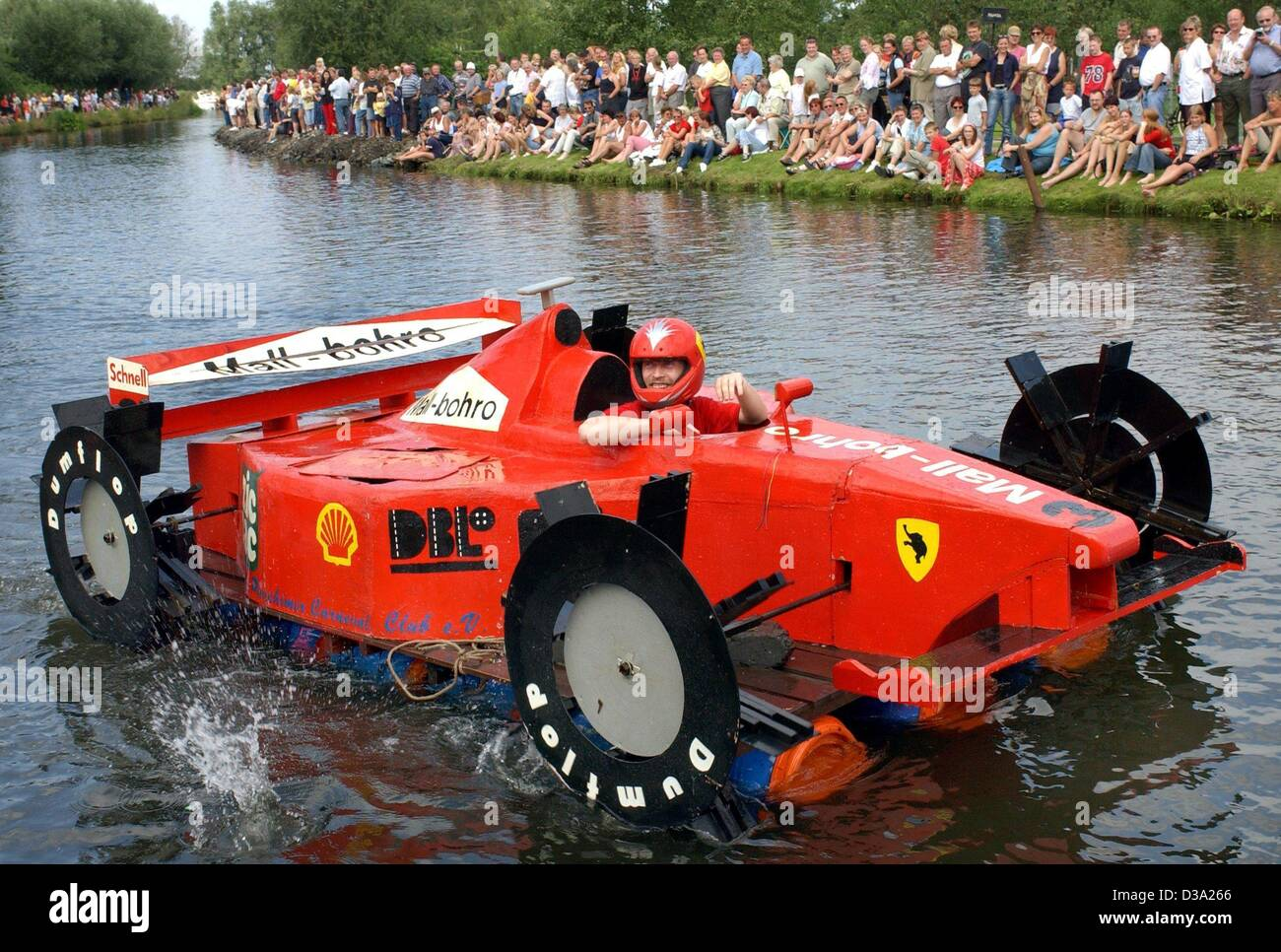 (dpa) - A swimming version of Schumacher's red Ferrari 'drives' along the river during the 8th 'Bath - Stock Image