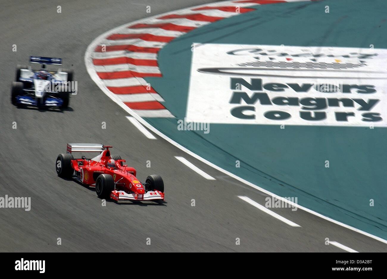 (dpa) - Ferrari pilot Michael Schumacher is closely followed by BMW Williams pilot Juan Pablo Montoya during the - Stock Image