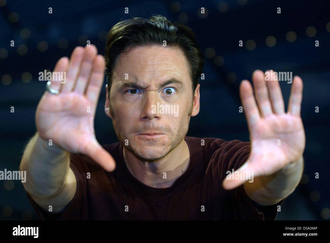 (dpa files) - Michael 'Bully' Herbig, German actor and film director, poses with an exorcizing gesture in a television show in Berlin, 12 July 2001. Herbig is the star of the German western comedy 'Der Schuh des Manitu' ('Manitou's Shoe'), which was a surprise hit at the Cannes film market and recen Stock Photo