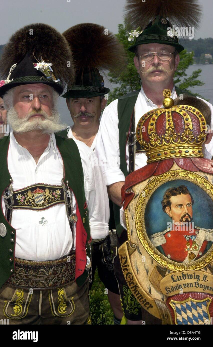 Loyals to King Ludwig II clad in traditional clothes attend a mass commemorating the death of the king in the village - Stock Image