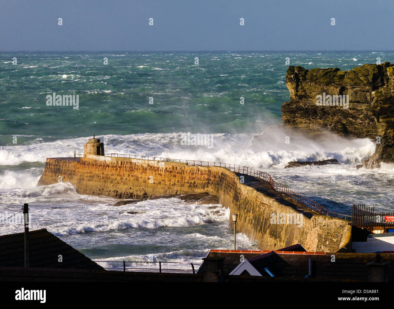 White water, rollers, waves and spume in the mouth of Portreath Harbour - Stock Image