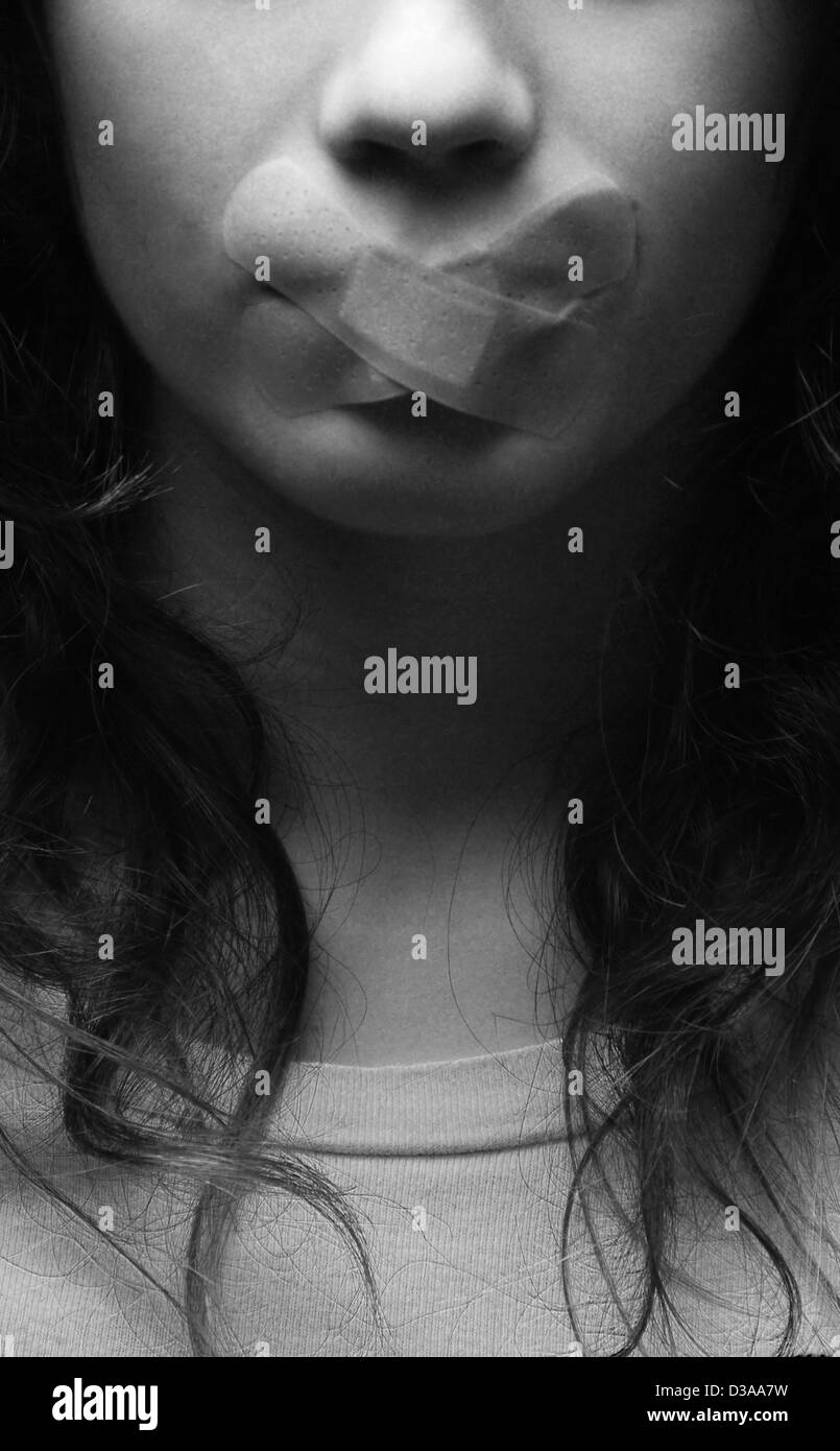 Woman with bandage over mouth Stock Photo