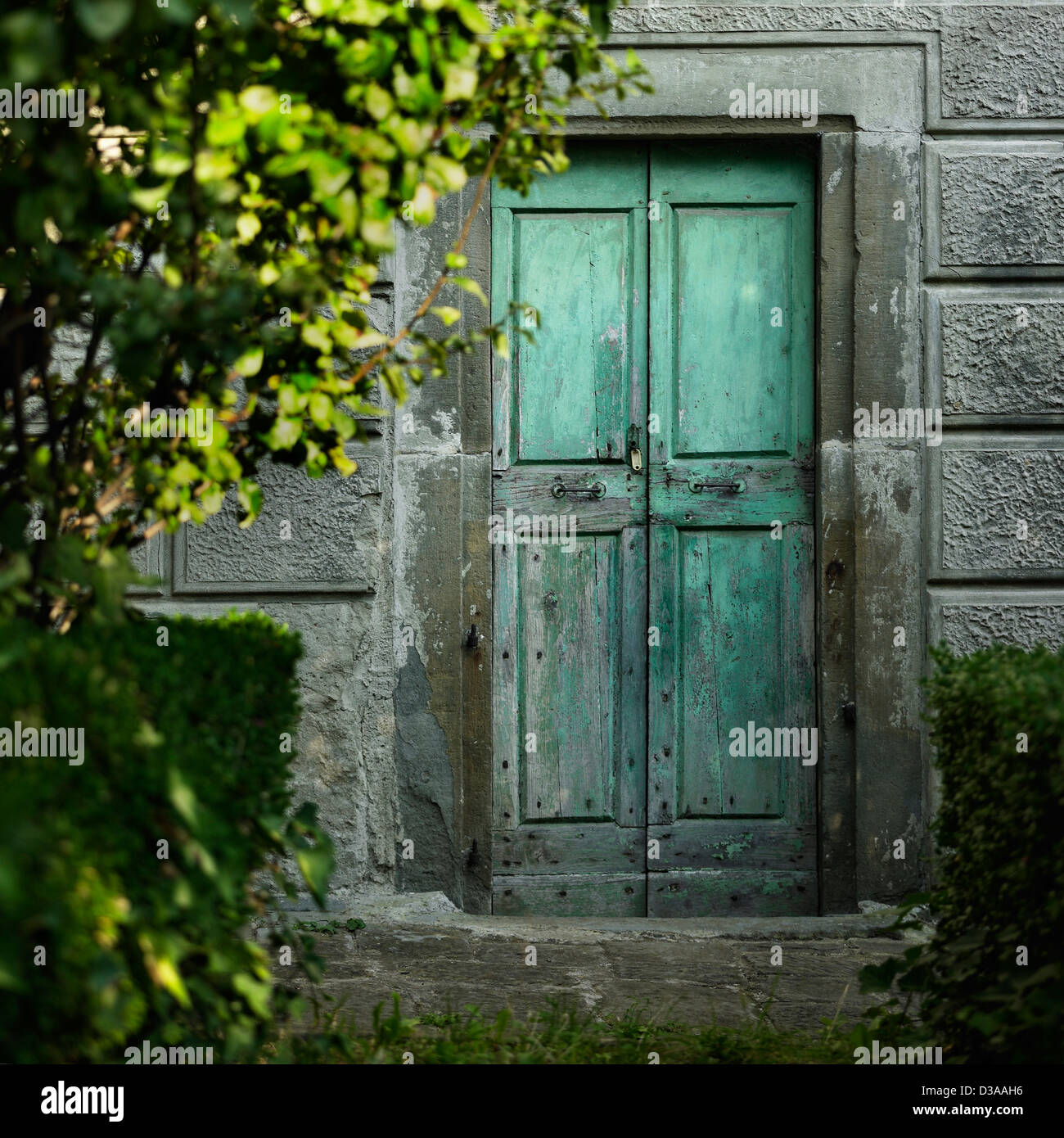 Old doors in concrete wall - Stock Image
