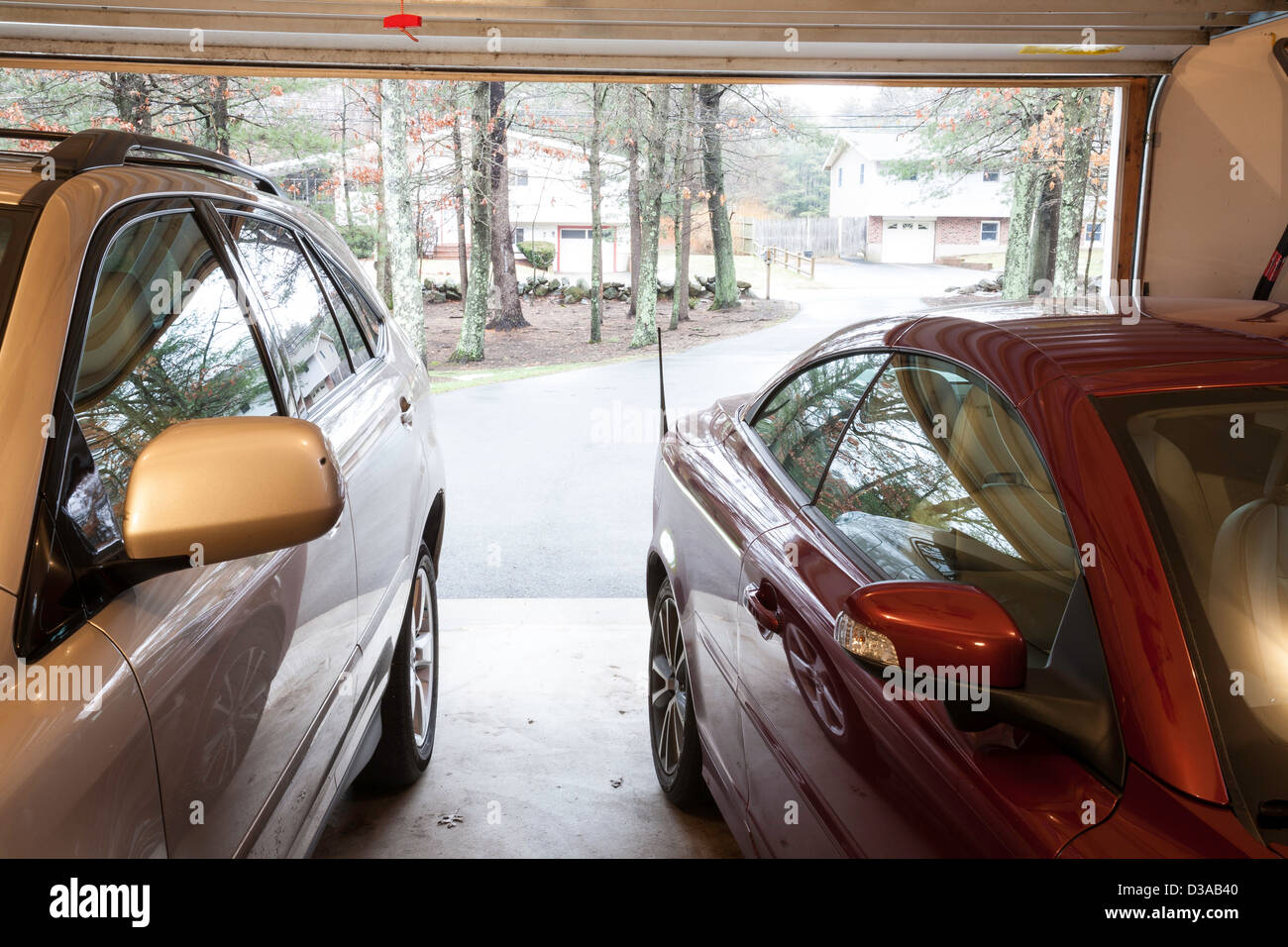 Automobiles in Two Car Suburban Garage Door Open  looking Down Driveway USA & Automobiles in Two Car Suburban Garage Door Open  looking Down ...
