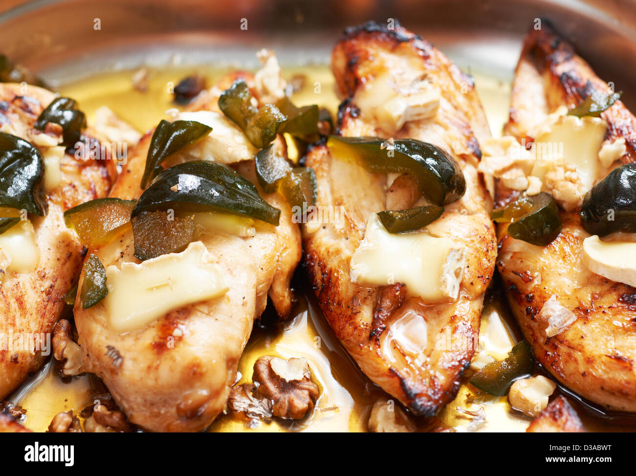 Mediterranean food of Provence, roasted chicken fillet with camembert cheese and figs - Stock Image
