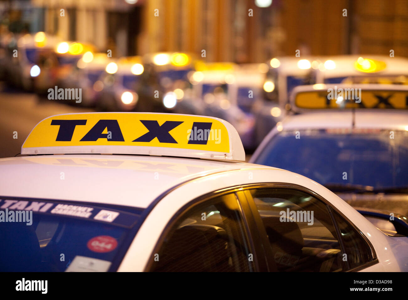 Taxi cabs and rank in Leeds , West Yorkshire - Stock Image