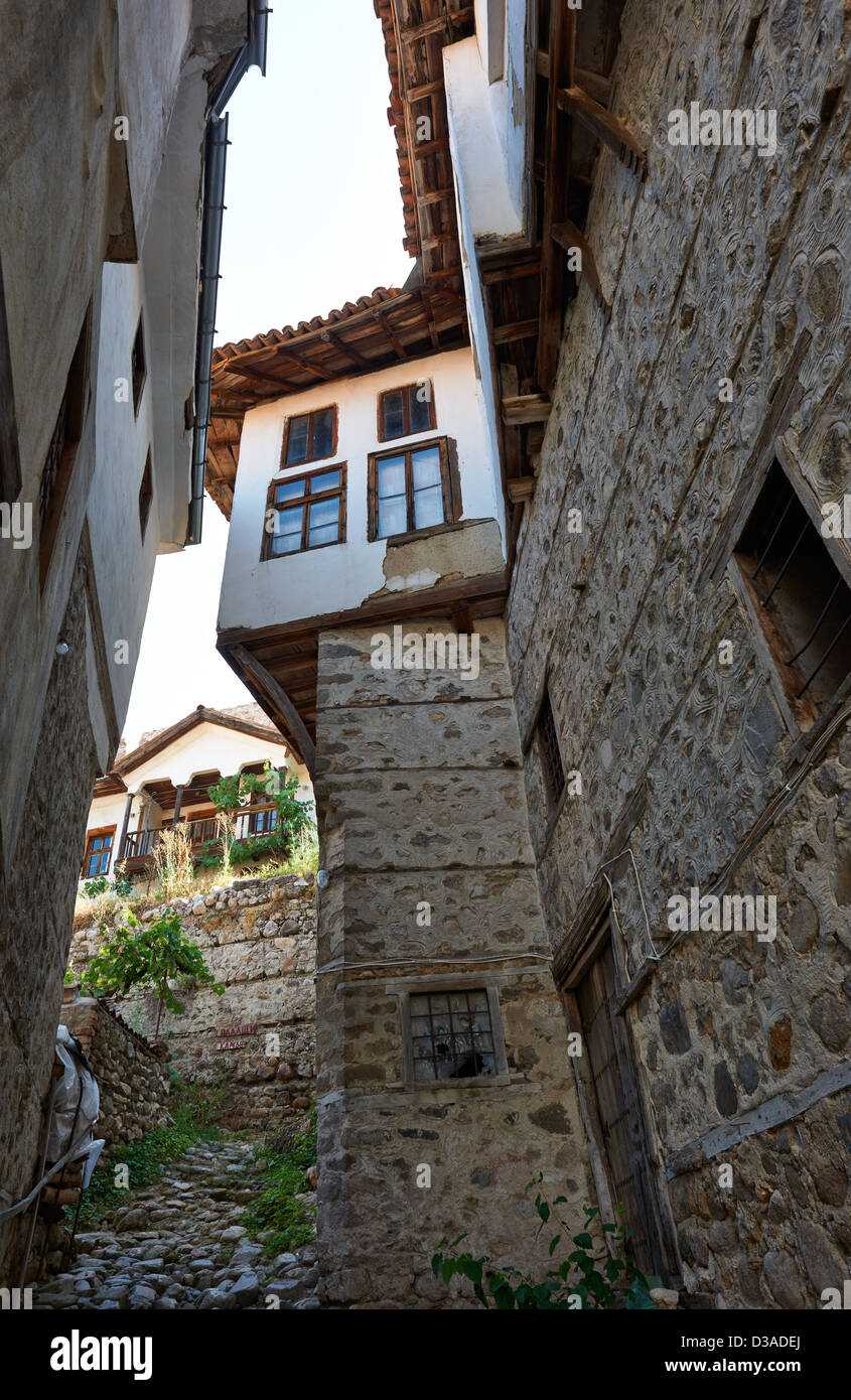 Narrow street with tall houses in smallest town of Bulgaria, Melnik - Stock Image