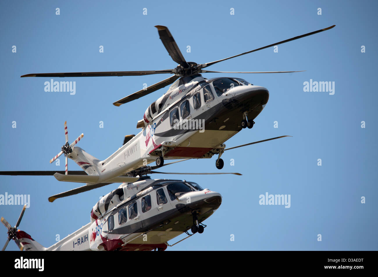 Agusta Westland helicopters flying during the Farnborough Airshow in England Stock Photo