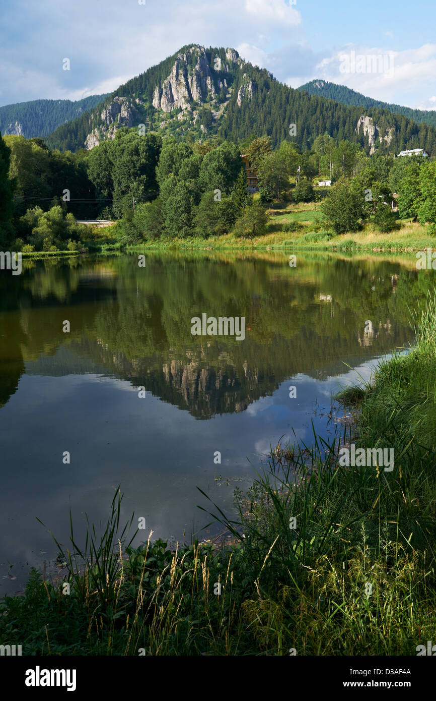 Lake and rocks near Smolian town, Rhodope mountains, Bulgaria in summer season - Stock Image