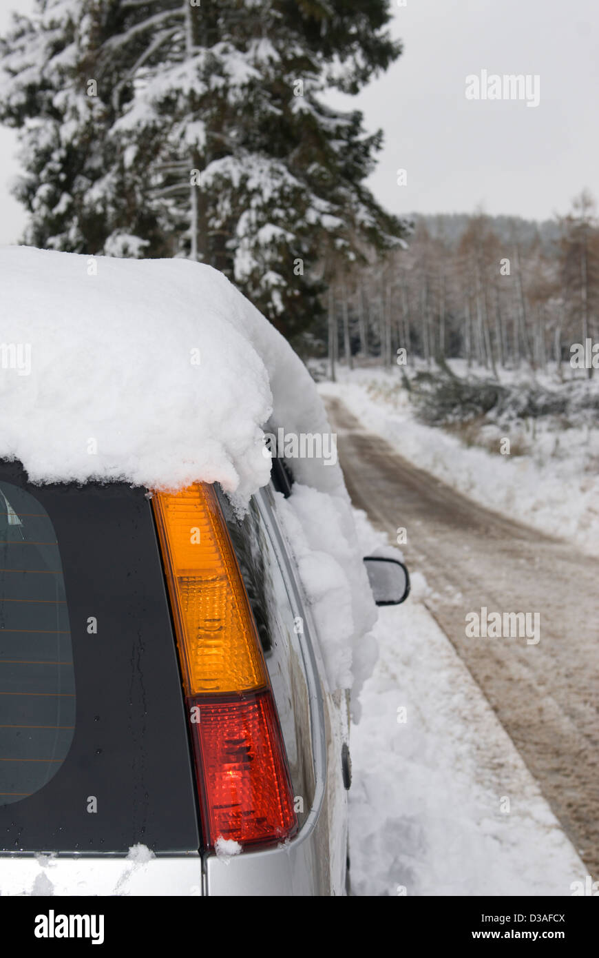 A Snow Covered Car On Passable Rural Road In Aberdeenshire