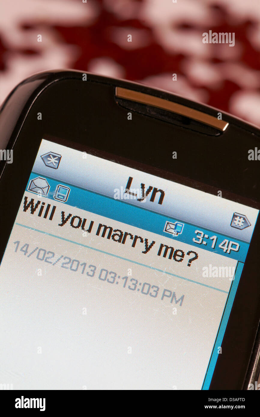 Will you marry me? - proposal received on mobile phone on St Valentines day Valentine day - Stock Image