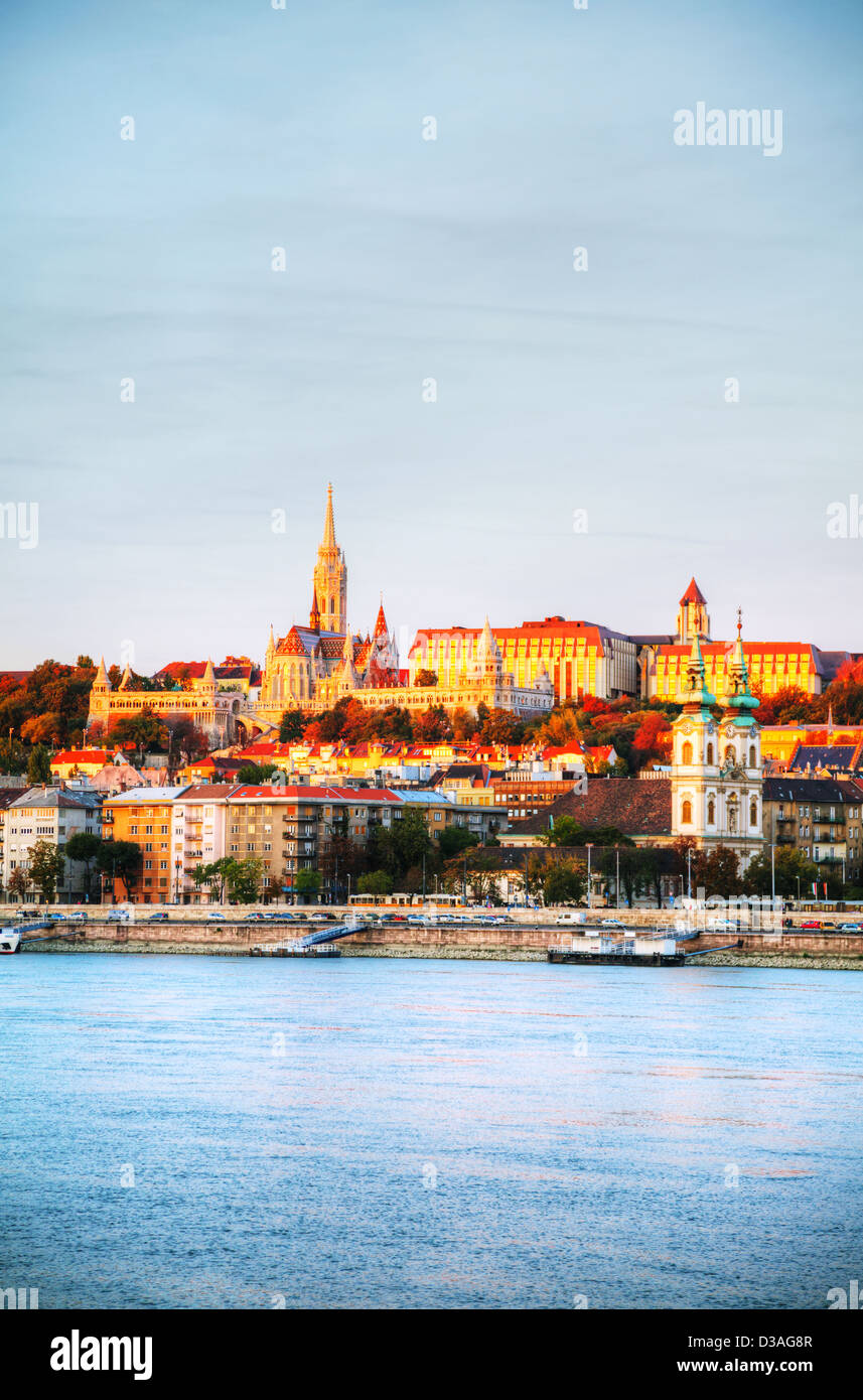 Old Budapest overview as seen from Danube river bank at sunrise - Stock Image