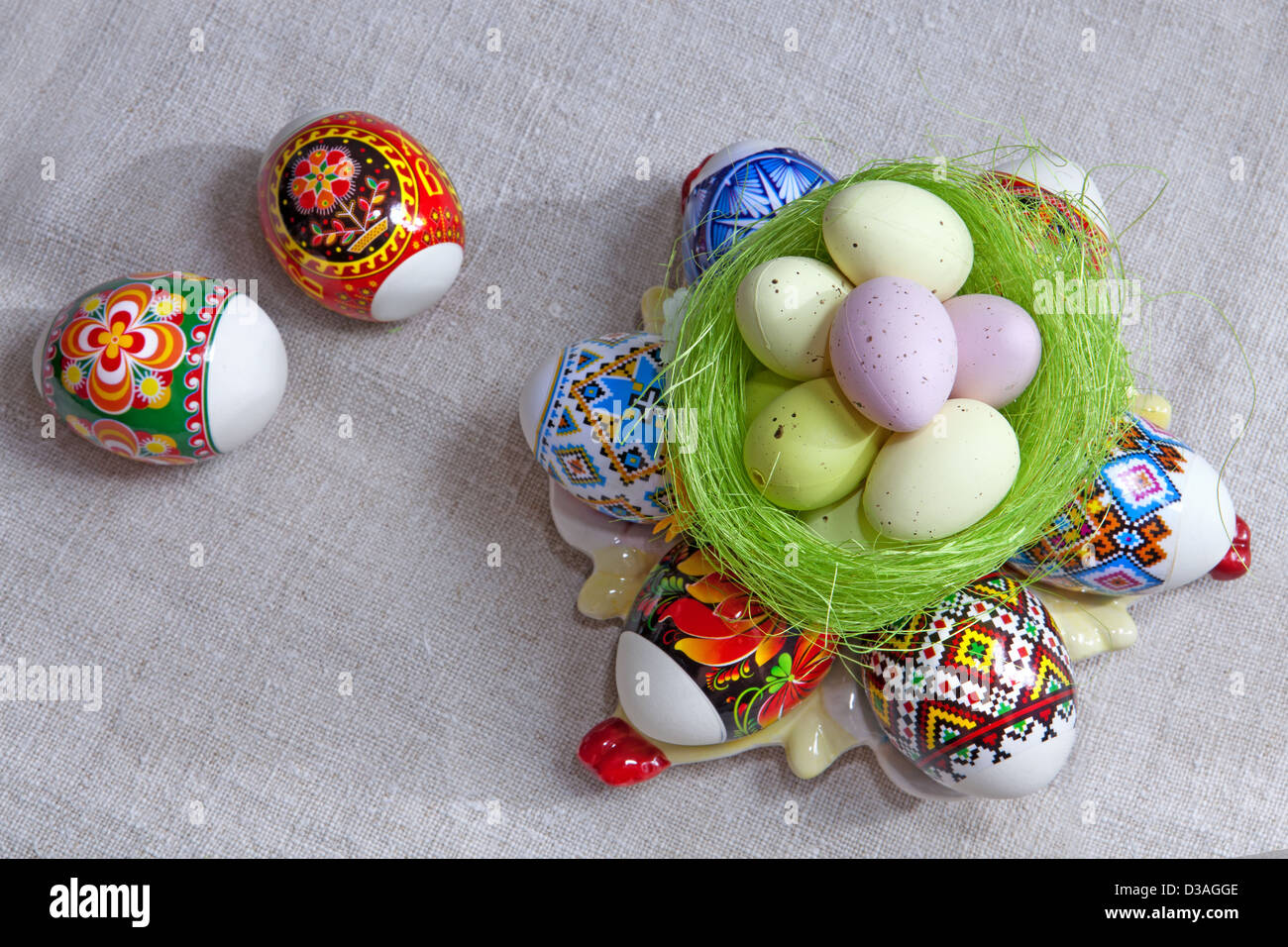Painted Colorful Easter Eggs on linen fabric - Stock Image