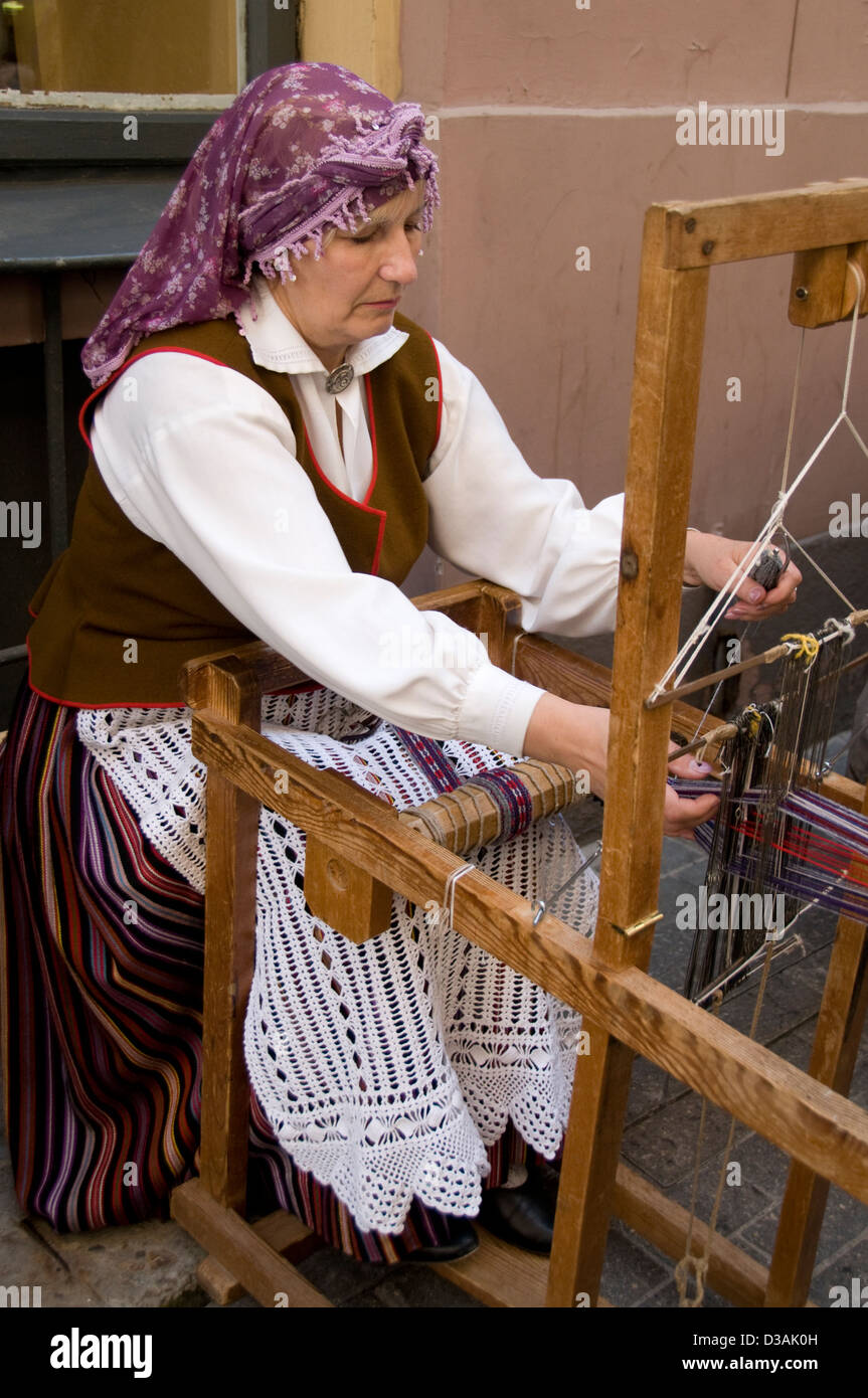 A wool spinner taking part in the old Latvain culture show in Amatu iela,Riga old town,Riga,Latvia,Baltic States - Stock Image