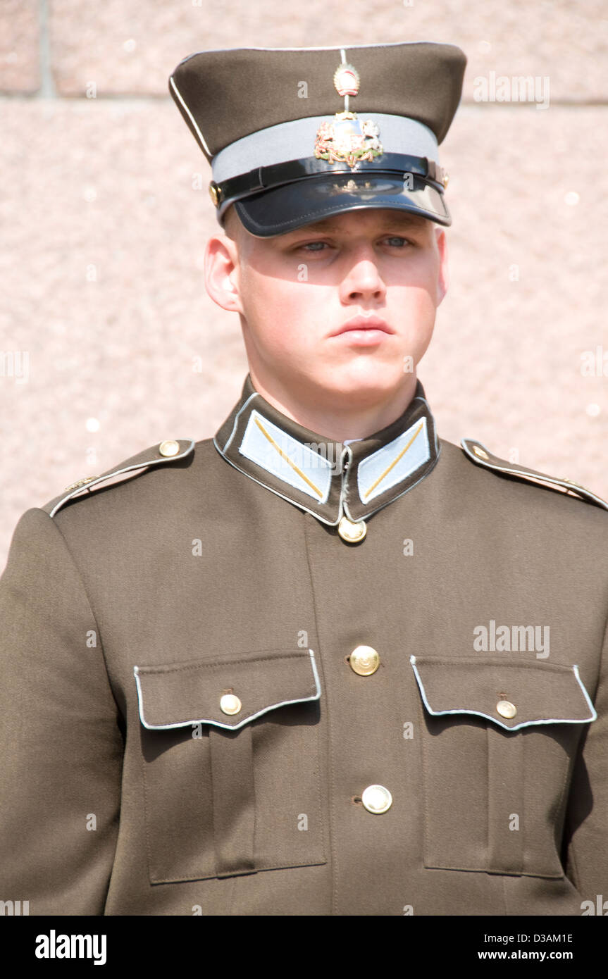 A Latvian sentry at the Monument of Freedom in Riga, - Stock Image