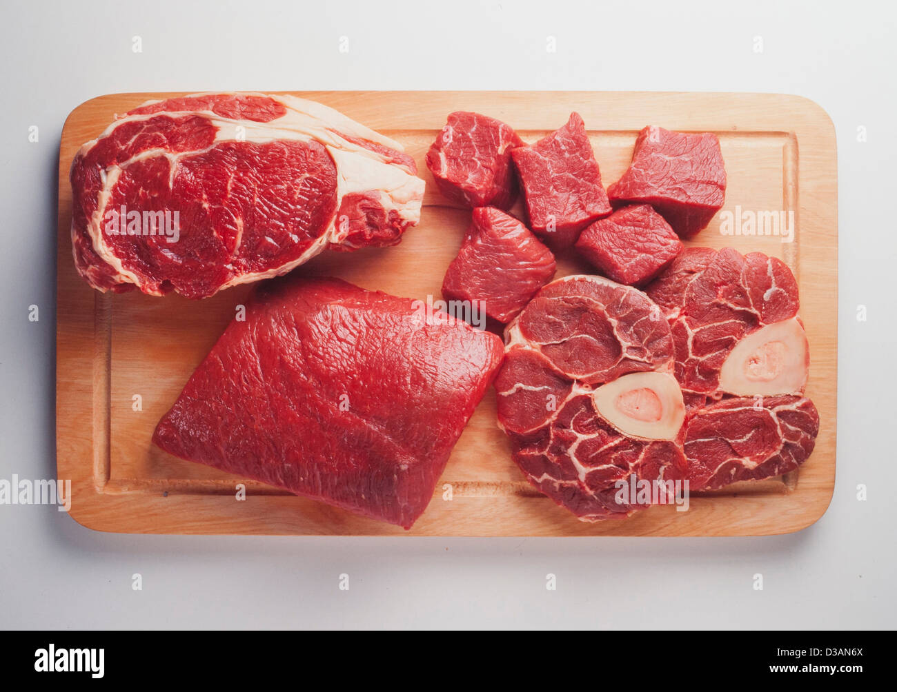table with different cuts of raw beef - Stock Image