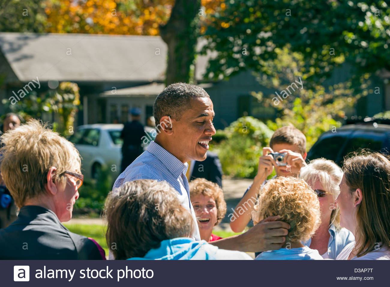 President Barack Obama greets supporters in a Des Moines, Iowa neighborhood during a back yard speech in 2010. - Stock Image