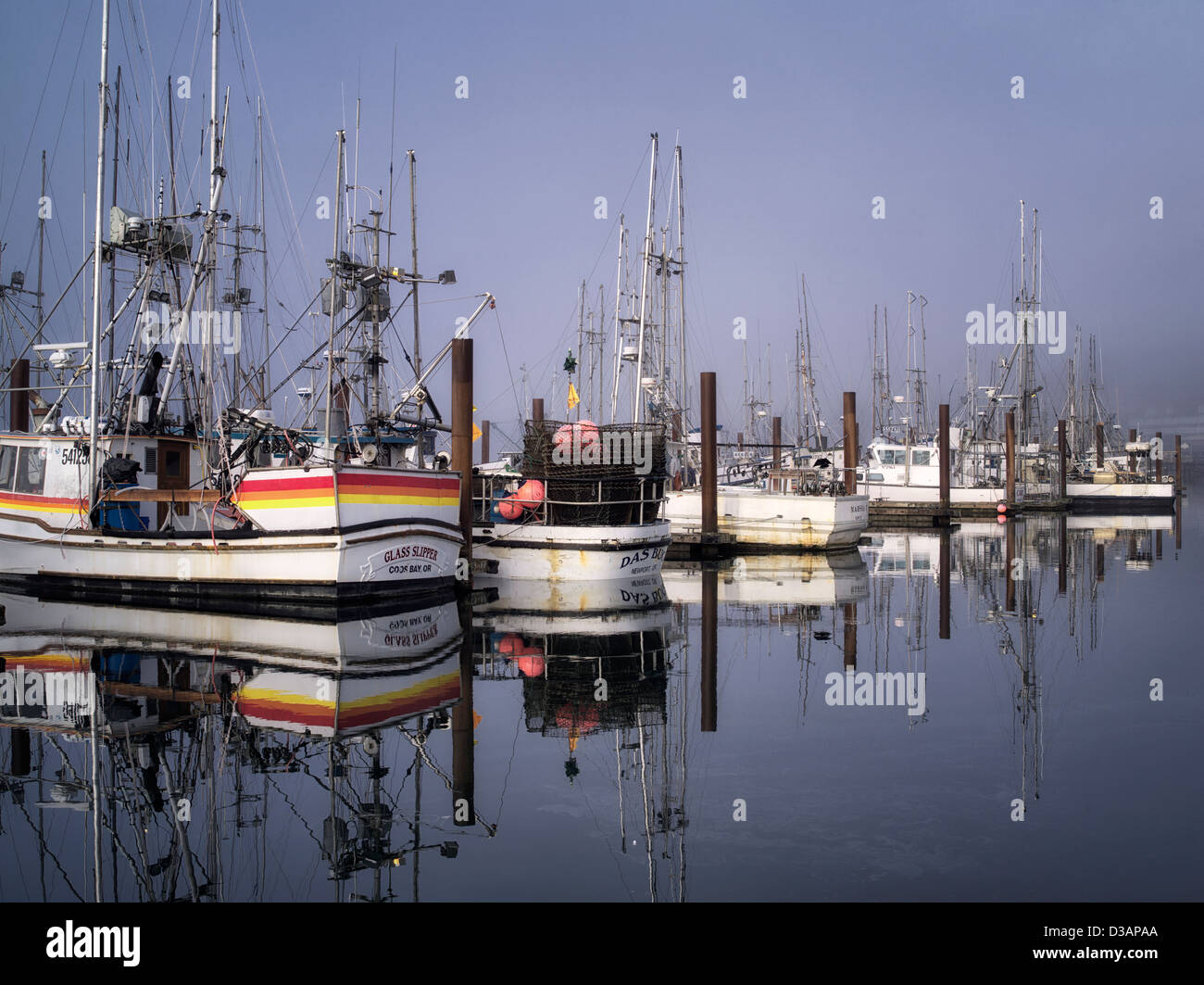 Fishing boats with fog at Newport Harbor. Oregon - Stock Image