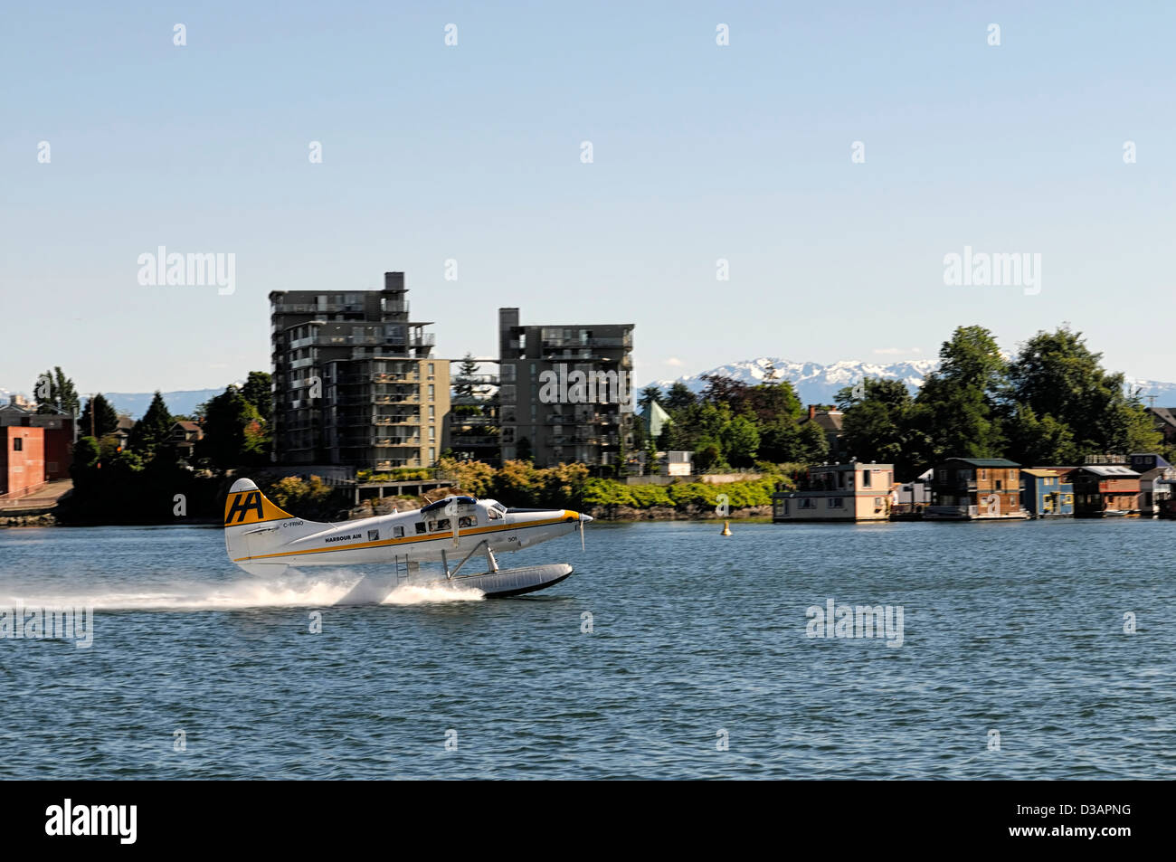 harbour air water plane take taking off takeoff inner harbour victoria vancouver island transport transportation - Stock Image
