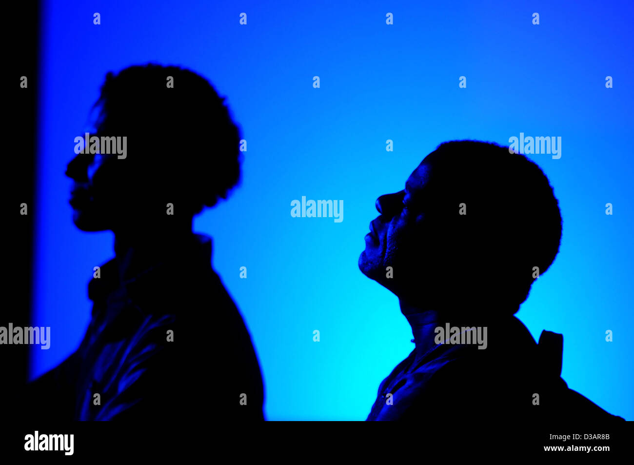 Berlin, Germany, silhouette, Africans listen to a concert - Stock Image