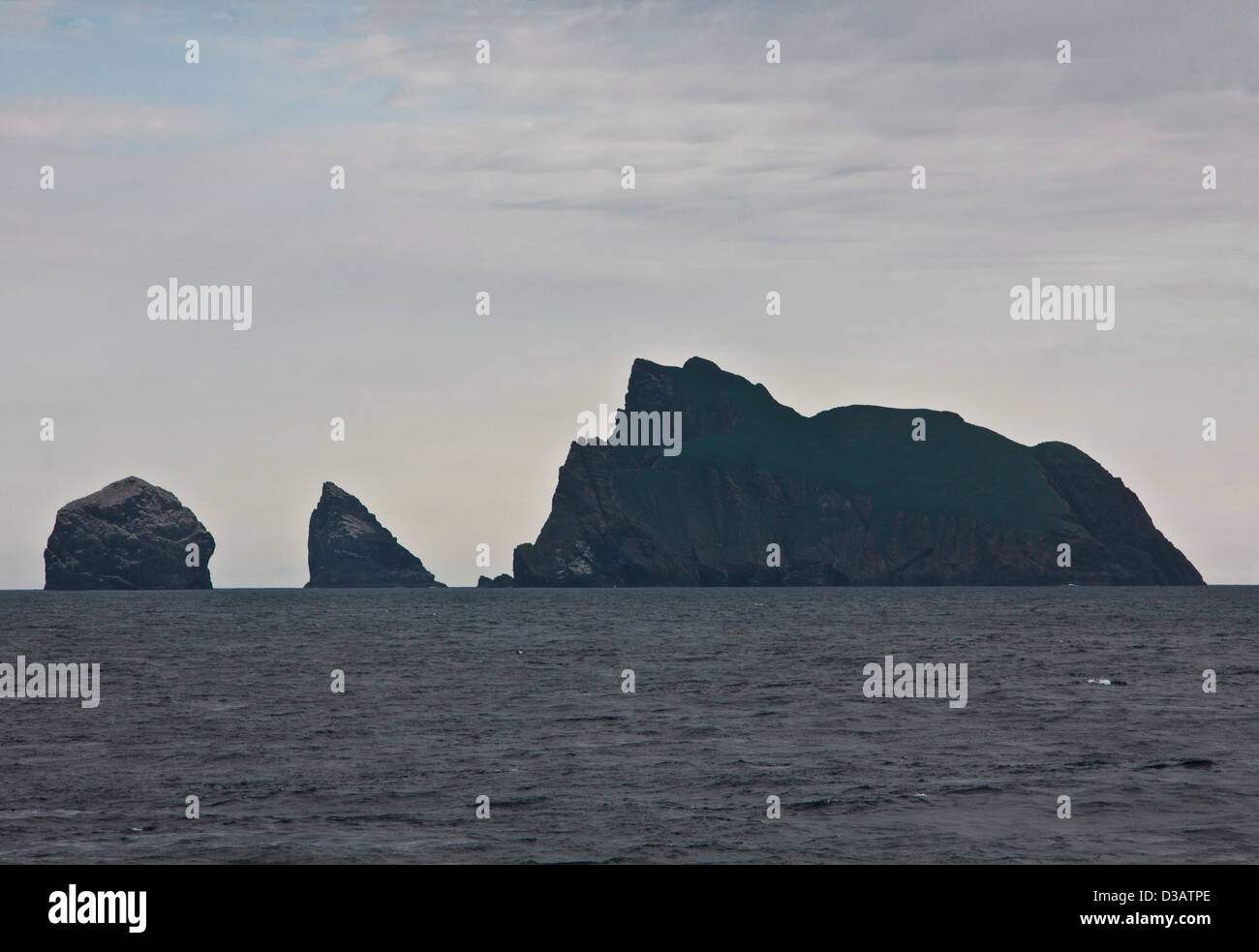 Sea stacs Lee and An Armin, together with the Island of Boreray arise from the mist in the Outer Hebrides, Western - Stock Image