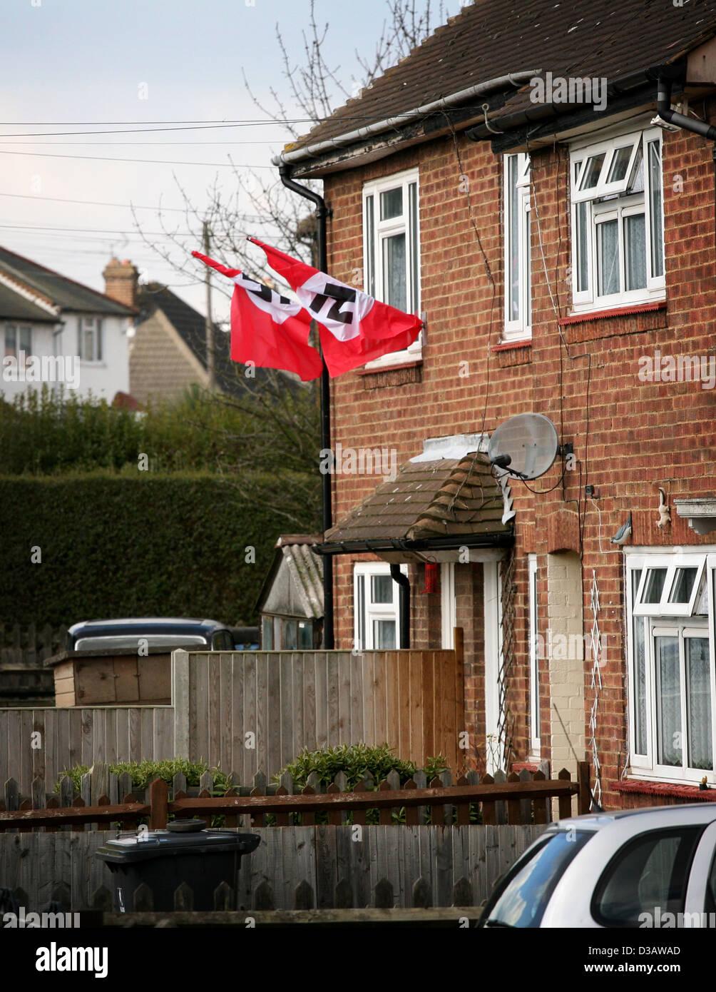 Nazi swastika flags hang outside a Luton UK house - Stock Image