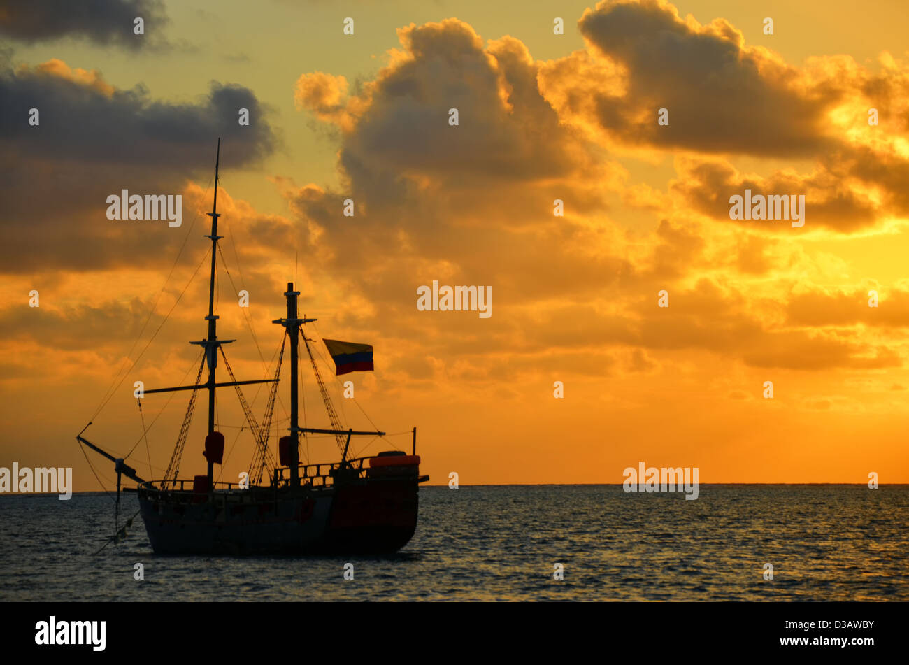 Caribbean sunrise with a pirate ship in San Andres, Colombia - Stock Image