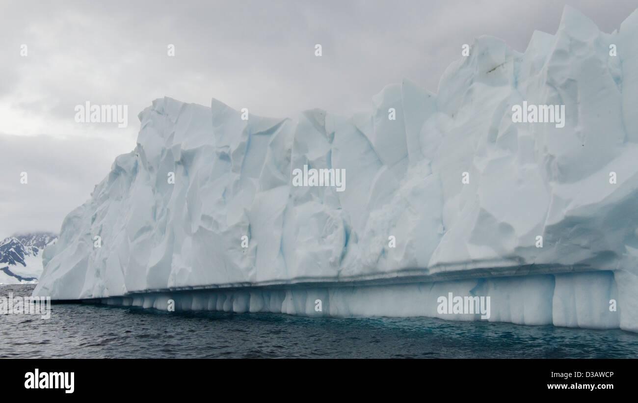 Jagged Iceberg. Antarctic Peninsula. - Stock Image