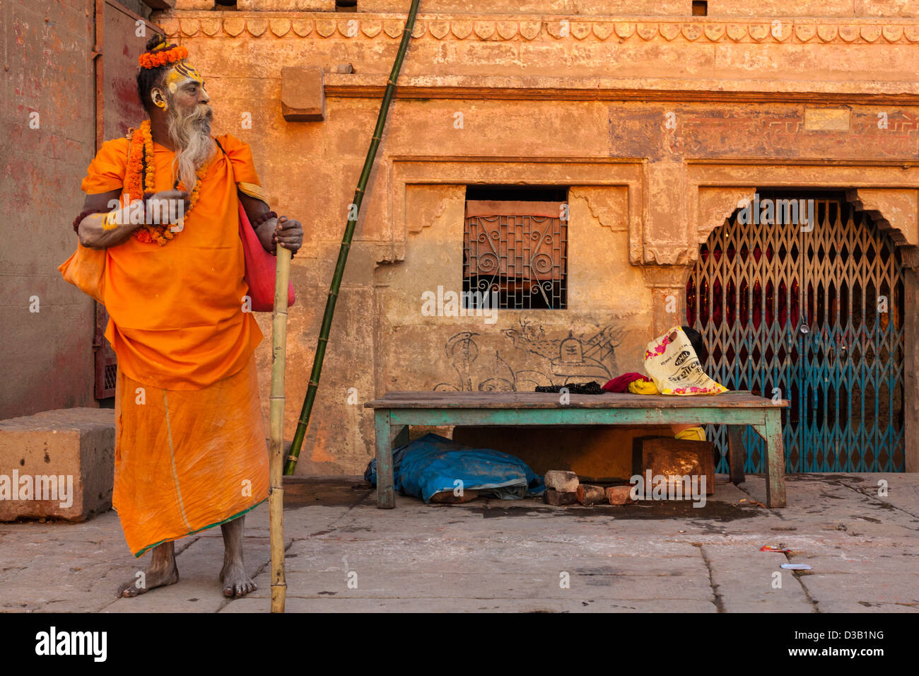 Sadhu standing at dawn, Varanasi, India - Stock Image