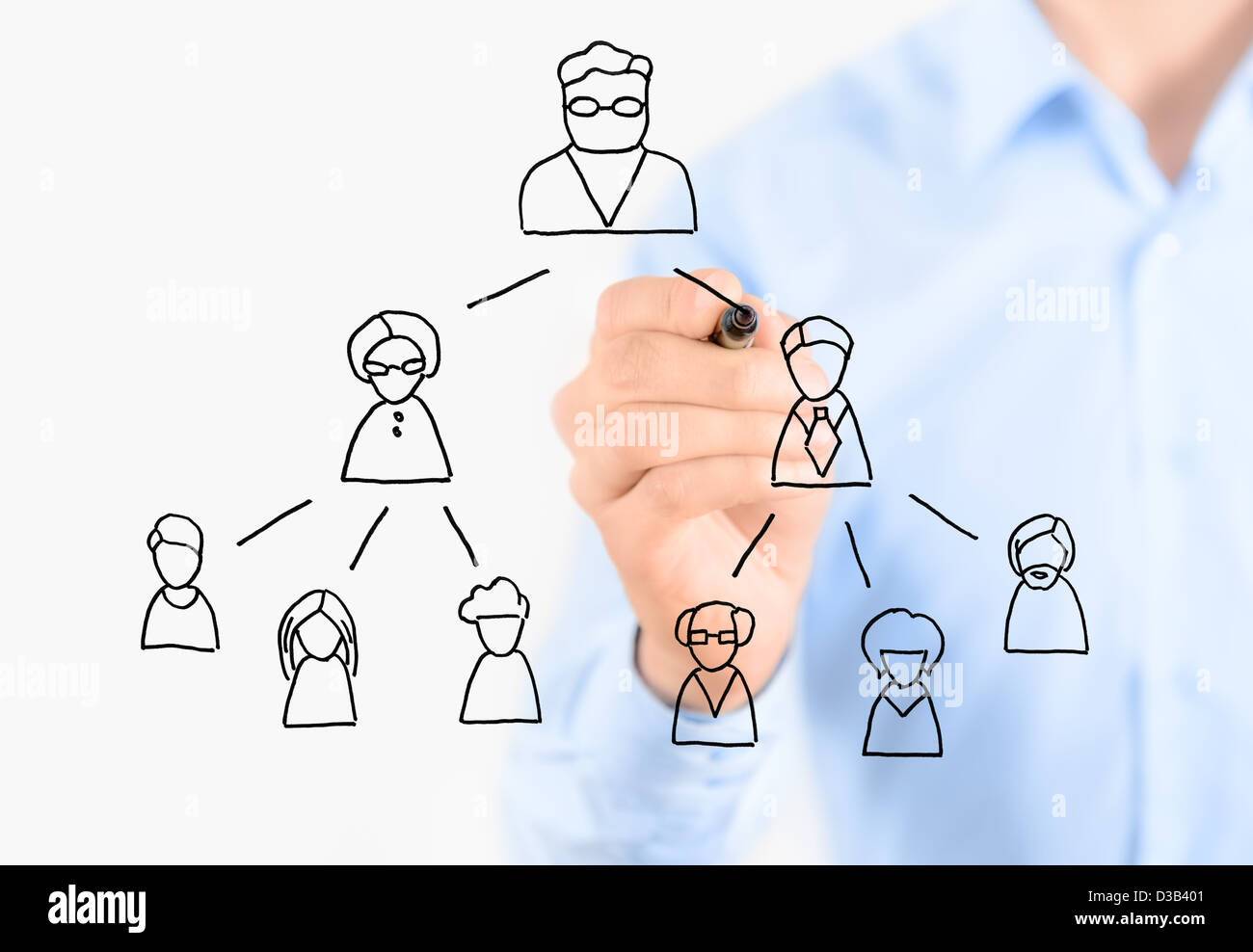 Businessman drawing multi level marketing scheme. Isolated on white. Stock Photo