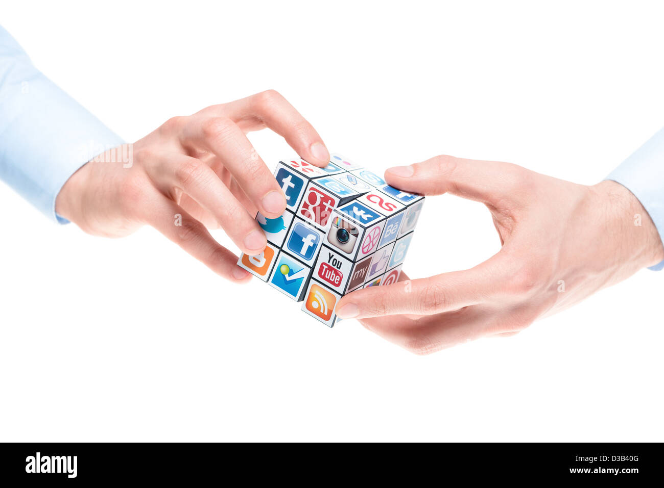 A hands holding rubik's cube with logotypes of well-known social media brand's. - Stock Image
