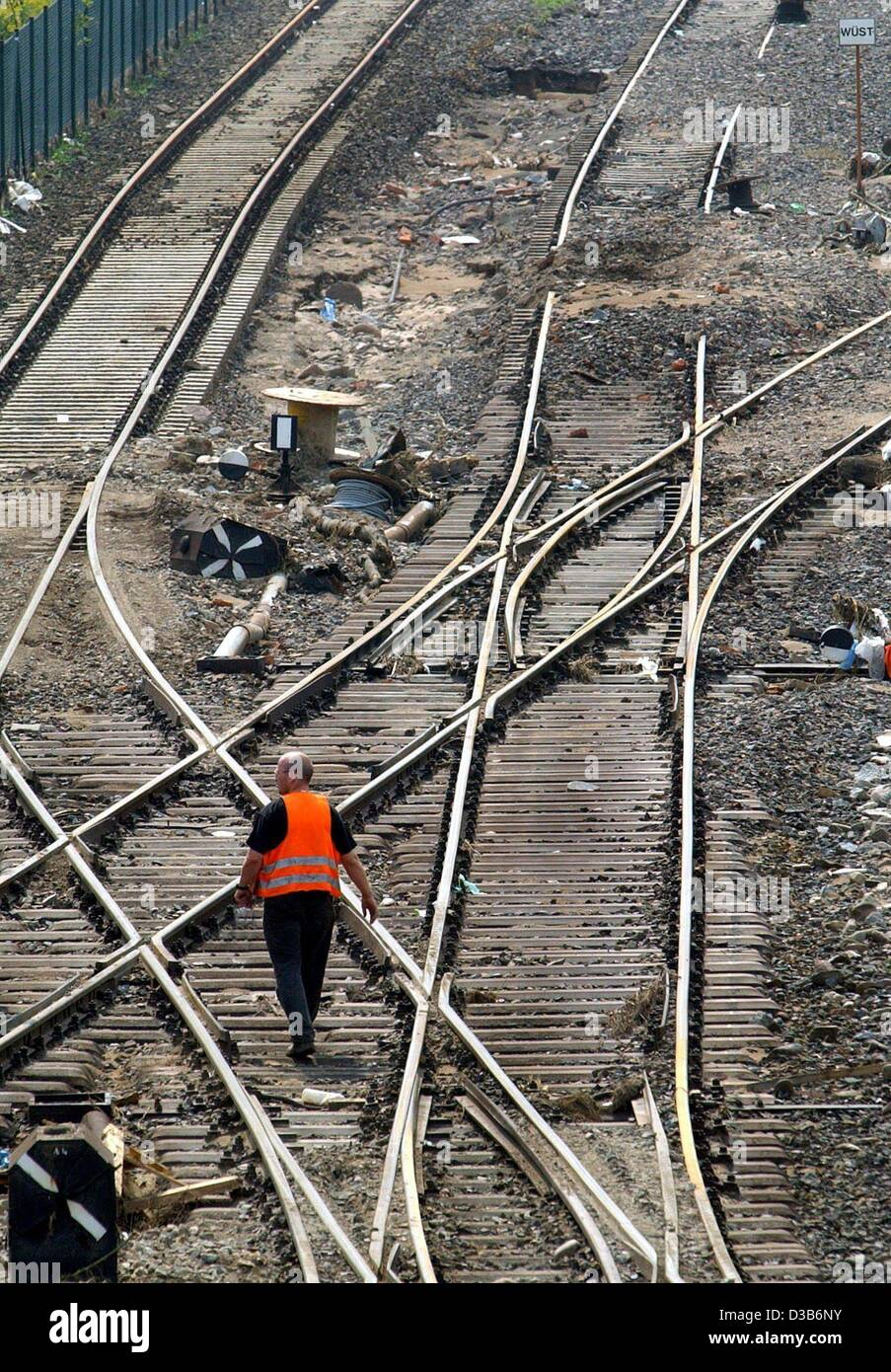 (dpa) - A worker walks over the sleepers of a railroad track devastated by the recent floods near Dresden, Germany, - Stock Image